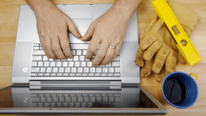Tradie viewing business website on laptop