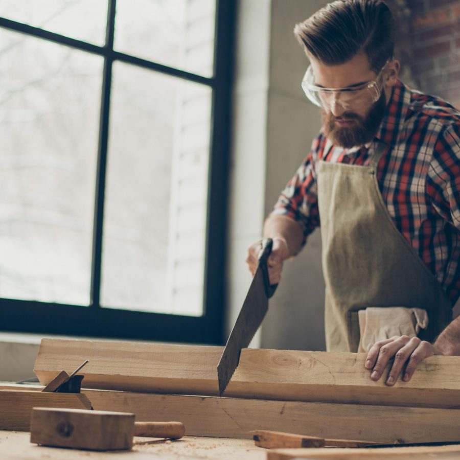 young stylish cabinet maker with glasses and hairstyle strong handsome craftsman holding saw and wood blank at workplace 944613244 5af9afc2a18d9e003c17040c scaled - Blog